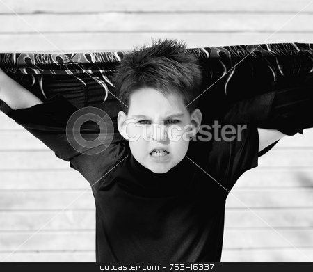 Boy with his shirt behind his head stock photo, Young boy with his shirt stretched behind his head and a scary look on his face. by Scott Griessel
