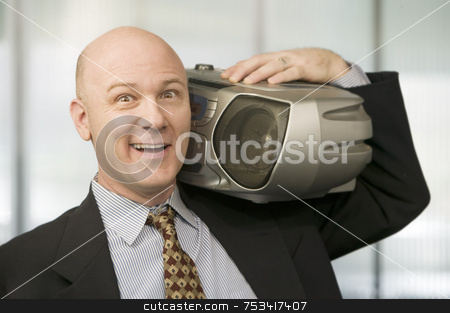 Businessman with a Boom Box stock photo, Smiling Businessman listening to a big Boom Box by Scott Griessel