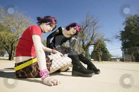 Two Punk Girls  stock photo, Two Punk Girls Sitting on a cement playground by Scott Griessel