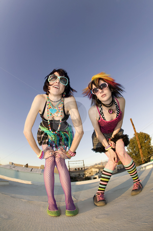 Punk Girls on a Roof stock photo, Fisheye shot of girls in brightly colored clothing on a roof by Scott Griessel