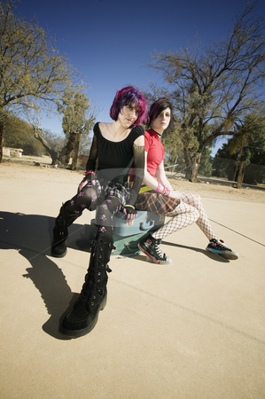 Two Punk Girls Sitting on Suitcases stock photo, Two Punk Girls Sitting on Stacked Suitcases by Scott Griessel