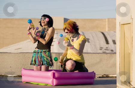 Punk Girls Juggling Plastic Balls stock photo, Punk Girls Juggling Plastic Balls on a Rooftop by Scott Griessel