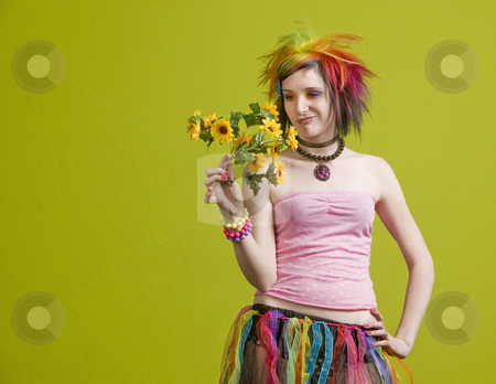 Punk woman with plastic flowers stock photo, Pretty young woman with colorful punk clothes considers plastic flowers. by Scott Griessel