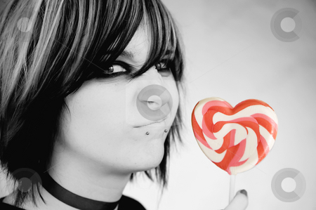 Alternative Girl with a Heart Lollipop stock photo, Alternative Girl with a Heart Lollipop Scrunches her Face by Scott Griessel