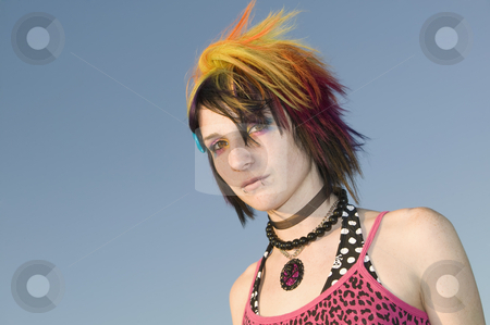 Young Punk Woman stock photo, Close-up of a young punk woman against a blue sky by Scott Griessel