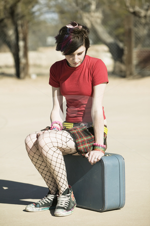 Punk Girl Sitting on Suitcase stock photo, Punk Girl Sitting on a Suitcase on a Cement Playground by Scott Griessel