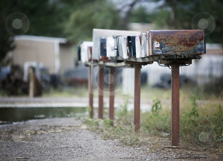 Rural Mailboxes stock photo, Rural mailboxes in a row alongside a country road. by Scott Griessel