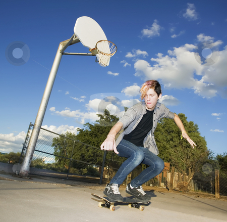 Teenage Skateboarder stock photo, Teenage boy skateboarder with his board. by Scott Griessel