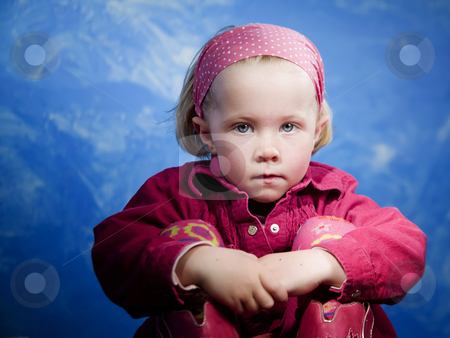 Little girl in front of blue stock photo, Little girl in studio in front of a blue wall by Scott Griessel