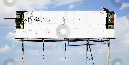 Old Billboard stock photo, Dilapidated old billboard falling apart against a cloudy sky. by Scott Griessel