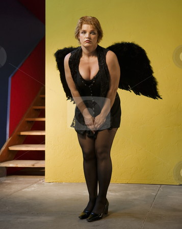 Angel 1 stock photo, Angel in black outfit and wings. by Scott Griessel