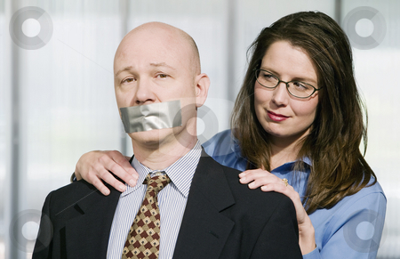 Business Portrait with Duct Tape stock photo, Portrait of Business team - the man is being muzzled with duct tape by Scott Griessel