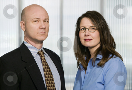 Businessman and Businesswoman stock photo, Portrait of Businesswomen and Businessman in an Office by Scott Griessel