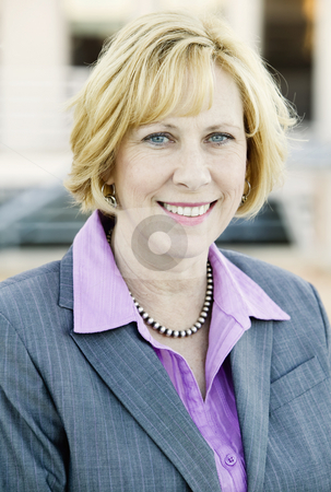 Business Woman stock photo, Blonde Business Woman in a Purple Shirt and Grey Suit by Scott Griessel