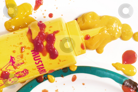Mustard Mess stock photo, Mustard squeeze bottle and a mess of condiments on a plate. by Scott Griessel
