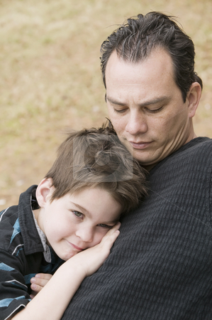 Man and Boy Relax stock photo, Portrait of a happy young man and a tired boy by Scott Griessel