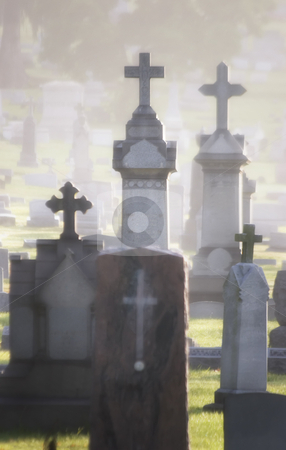 Misty Cemetery stock photo, Misty cemetary at dawn featuring headstones and memorials.  All names have been obscured. by Scott Griessel
