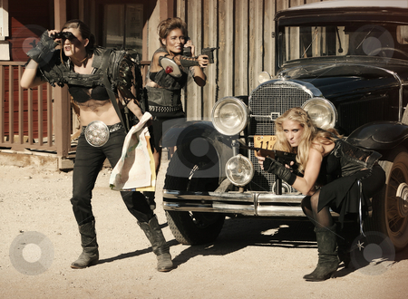 Shootout stock photo, Three tough women engage in a shootout over a vintage car. by Scott Griessel