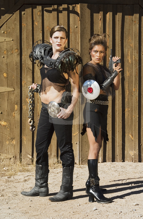 Tough Women stock photo, Tough science-fiction women in costumes with weapons. by Scott Griessel