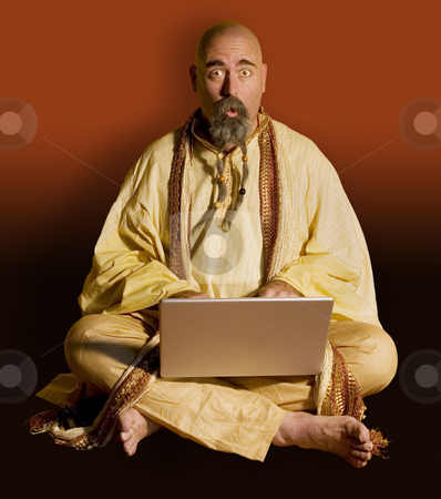 Funny Guru with a LapTop Computer stock photo, Funny Guru Sitting Lotus Style with a LapTop Computer by Scott Griessel