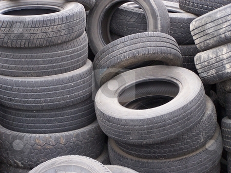 Pile of old tires for recycle stock photo, A heap of dumped car tires cause a blight on the landscape by CHERYL LAFOND