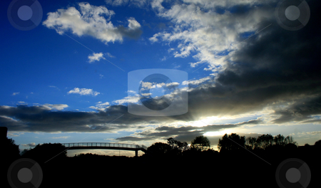 Bridge Sunset stock photo, A silhouette of a bridge in sunset. by Lucy Clark