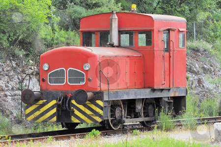 Locomotive stock photo, Red locomotive used to move wagons stopped on railroad by Massimiliano Leban