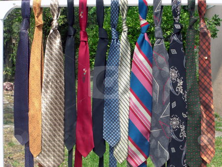 Ties On A Rail stock photo, A colorful line of men's neckties are hanging on a rail by Rebecca Mosoetsa