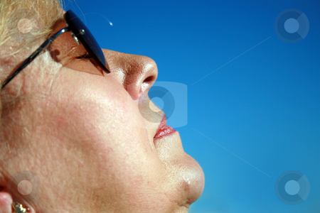Woman Relaxing stock photo, Carole sunbathing in Florida, relaxing in the sun. by Lucy Clark