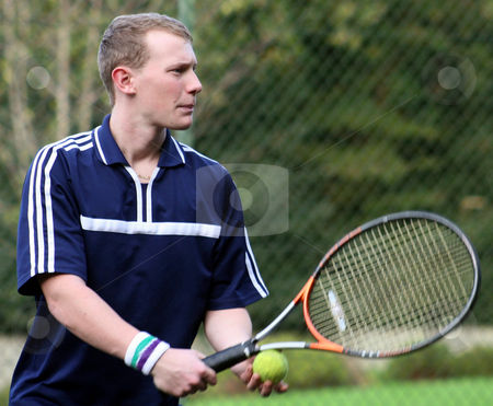 James Tennis stock photo, James ready to serve his game of tennis. by Lucy Clark