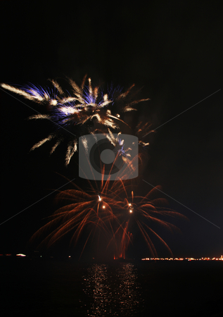 Hairy fireworks stock photo, Hairy and colorful fireworks by the bay by Jonas Marcos San Luis