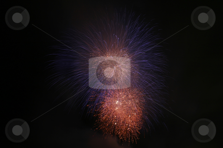 Silky blue and fiery orange fireworks stock photo, Silky blue and fiery orange fireworks at night by Jonas Marcos San Luis