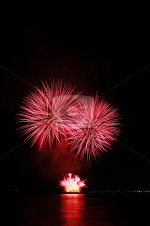 Fiery red fireworks stock photo, Fiery red fireworks against the dark sky by Jonas Marcos San Luis