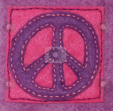 Hand-sewn Peace Sign stock photo, An anti-war symbol hand sewn on felt by Philippa Willitts