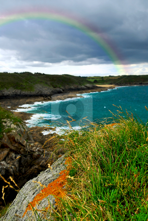 Atlantic coast in Brittany stock photo, Landscape of rocky Atlantic coast in Brittany France with stormy sky and rainbow by Elena Elisseeva