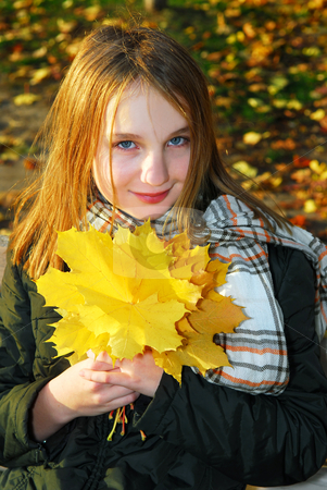 Girl with autumn leaves stock photo, Portrait of a beautiful teenage girl with yellow fall maple leaves by Elena Elisseeva
