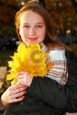 Girl with fall leaves stock photo, Portrait of a beautiful teenage girl with yellow fall maple leaves by Elena Elisseeva