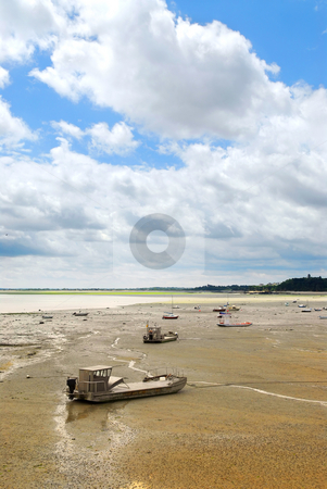 Fishing boats in Cancale, France stock photo, Fishing boats on the ocean floor at low tide in Cancale (Brittany, France). by Elena Elisseeva