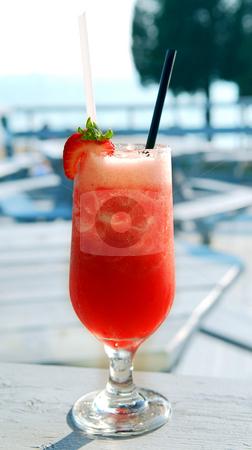 Strawberry daiquiri stock photo, Strawberry daiquiri cocktail served in a cold glass on a patio by Elena Elisseeva