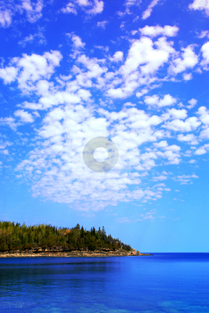 Scenic lake view stock photo, Beautiful view of a scenic lake with clear water and spectacular sky. Georgian Bay, Canada. by Elena Elisseeva