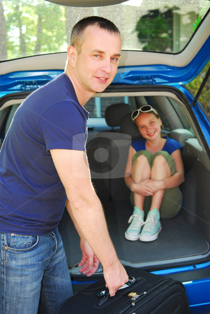 Family trip stock photo, Father loading luggage in a car for a family trip by Elena Elisseeva