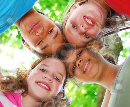 Four girls stock photo, Faces of four happy young girls shot from below by Elena Elisseeva