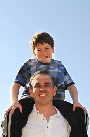 Father and son stock photo, Portrait of father and son playing outdoors by Elena Elisseeva