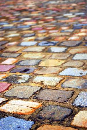 Colorful cobblestones stock photo, Background of colorful cobblestone pavement close up by Elena Elisseeva