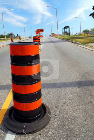 Road construction stock photo, Road construction signs and cones on city street by Elena Elisseeva