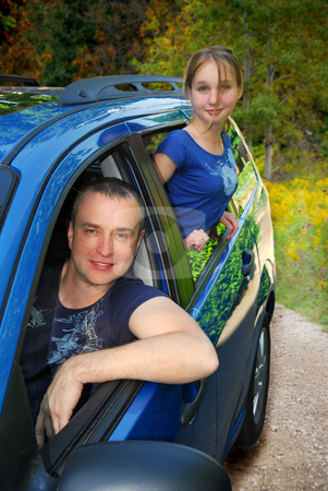 Family trip stock photo, Father and daughter  inside a car on country road by Elena Elisseeva