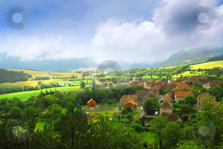 Rural landscape stock photo, Rural landscape with hills and village in eastern France by Elena Elisseeva