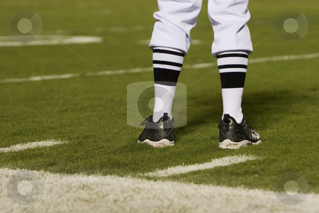 Referee's Feet on the Field stock photo, Referre's feet on a football field from behind. by Scott Griessel