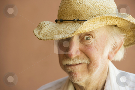 Senior Citizen Man in a Cowboy Hat stock photo, Senior Citizen Man in a Straw Cowboy Hat by Scott Griessel