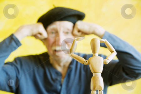 Artist Mimics a Wooden Figure stock photo, Crazy artist pmimics a wooden figure model by Scott Griessel